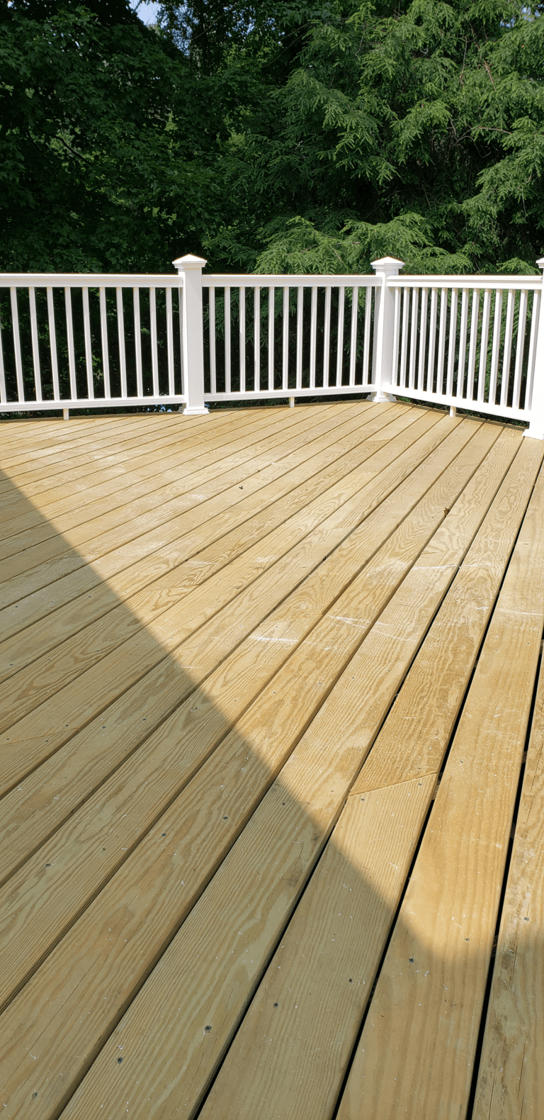 Pressure Treated Boards and Composite Railings will ensure that this new deck construction lasts for years to come