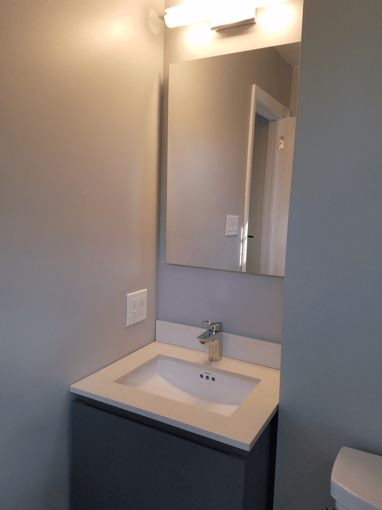 This Bathroom Sink and Mirror were the final touches to this full bathroom remodel in Wilton, CT